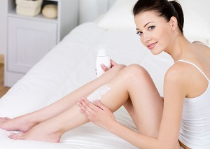 Women using hair removal cream