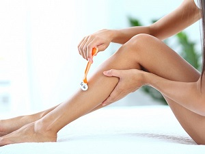 Women Shaving Leg Hair